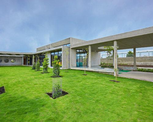 Foto e idee per facciate di case facciata di una casa for Cemento industriale in casa