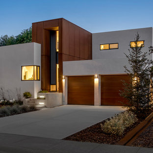 Inspiration for a modern beige two-story metal exterior home remodel in Edmonton
