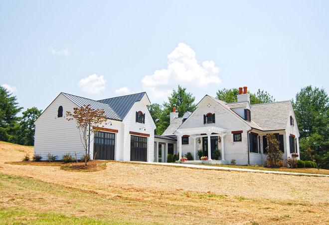 Farmhouse Exterior by Custom Structures Inc