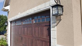 Insulated Designer Garage Doors & Stone Siding
