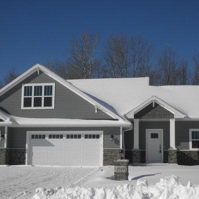 Mid-sized elegant gray split-level vinyl exterior home photo in Other