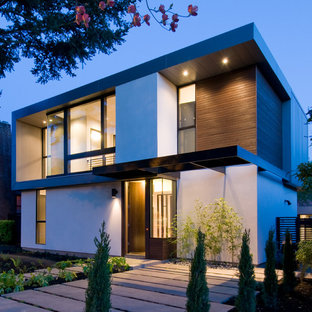 Example of a mid-sized minimalist white two-story mixed siding exterior home design in Portland