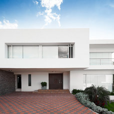 Modern Exterior by Innovation Design And Construction Inc.