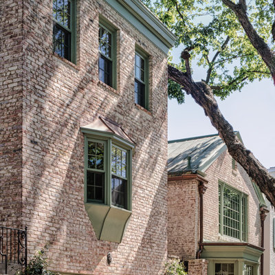 Large traditional three-story brick exterior home idea in DC Metro