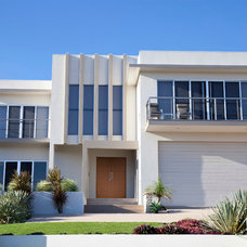 Contemporary Exterior by Madero Doors & Hardware