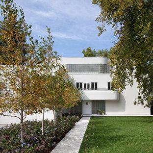 Modern white three-story exterior home idea in Minneapolis
