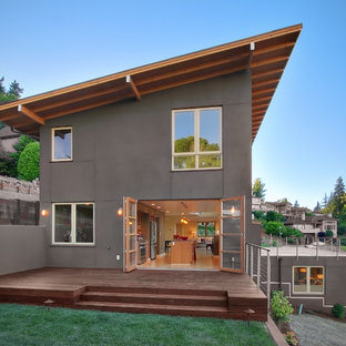 Contemporary three-story exterior home idea in Seattle with a shed roof