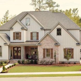 Mid-sized elegant white two-story mixed siding gable roof photo in Atlanta