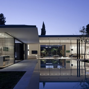 Example of a trendy one-story glass exterior home design in San Francisco