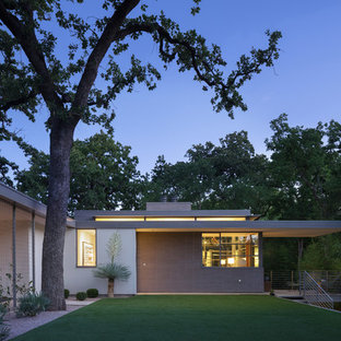 Inspiration for a 1960s brown one-story brick exterior home remodel in Austin