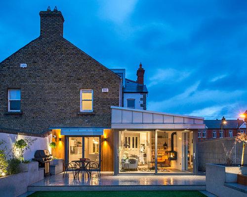 Foto e idee per facciate di case facciata di una casa con tetto a