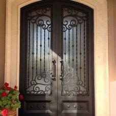 Mediterranean Exterior by Colletti Design Iron Doors