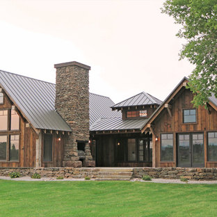 Inspiration for a rustic red one-story wood gable roof remodel in Other with a metal roof