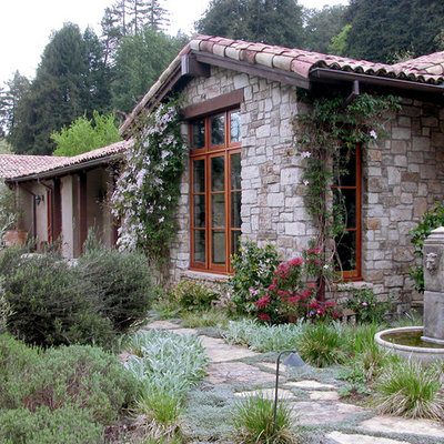 Example of a classic stone exterior home design in Other