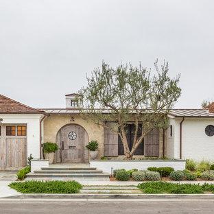 Mediterranean exterior home idea in Orange County