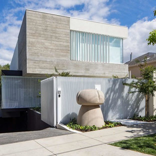 Inspiration for a modern two-storey white exterior in Melbourne with mixed siding and a flat roof.