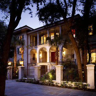 Design ideas for a large and beige mediterranean two floor render house exterior in Atlanta.