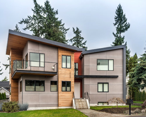 Large contemporary gray two-story mixed siding exterior home idea in  Seattle with a shed