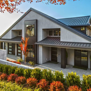 Contemporary gray two-story house exterior idea in Seattle with a metal roof
