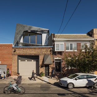 Urban multicolored two-story mixed siding exterior home photo in Philadelphia with a shed roof