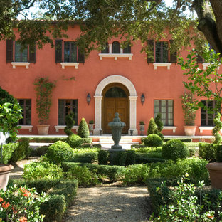 Inspiration for a mediterranean red two-story exterior home remodel in Miami