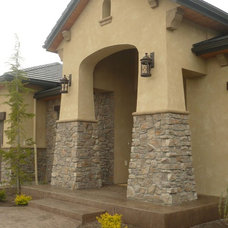 Eclectic Exterior by THE MASONRY CENTER INC