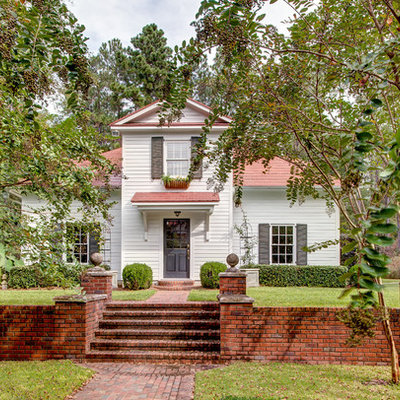 Traditional white two-story wood exterior home idea in Atlanta