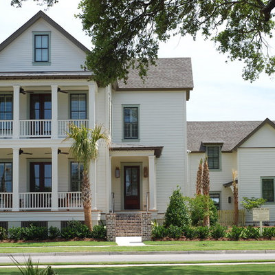 Inspiration for a timeless wood exterior home remodel in Charleston