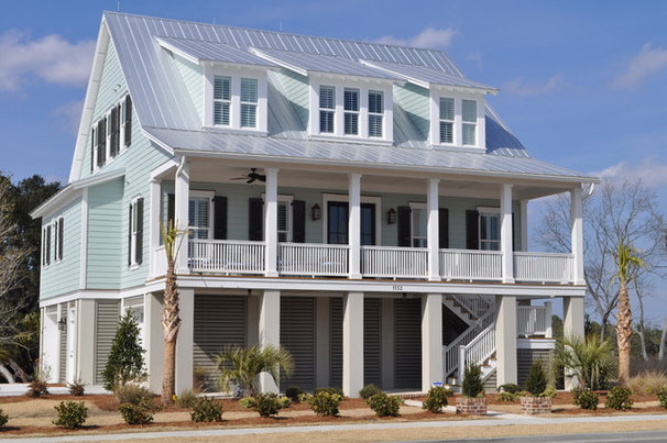 Tropical Exterior by JacksonBuilt Custom Homes