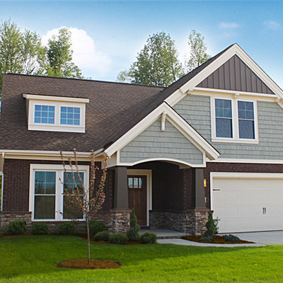 Mid-sized craftsman blue two-story mixed siding exterior home idea in Other with a shingle roof