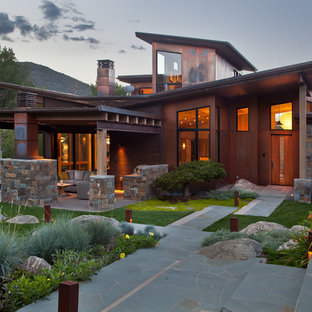 Inspiration for an expansive and brown world-inspired two floor exterior in Denver with mixed cladding and a lean-to roof.