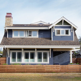 Large craftsman blue two-story stucco exterior home idea in Other