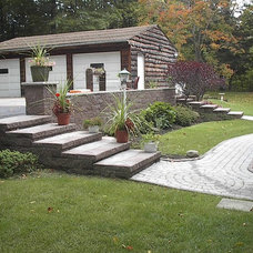 Exterior by custom landscape & patio
