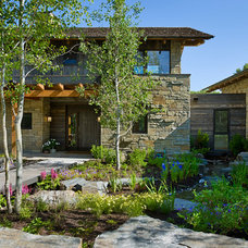 Rustic Exterior by Carney Logan Burke Architects