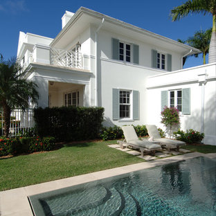 Inspiration for a tropical white exterior home remodel in Miami