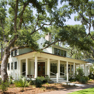 Example of a country wood exterior home design in Atlanta