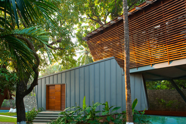 Tropical Exterior by Malik Architecture