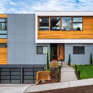 シアトルのコンテンポラリースタイルのおしゃれな家の外観 (コンクリート繊維板サイディング、陸屋根、戸建) の写真