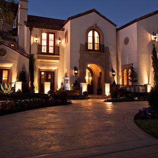Design ideas for a beige mediterranean two floor render exterior in Dallas with a pitched roof.