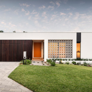 Contemporary one-storey white house exterior in Perth with mixed siding and a flat roof.