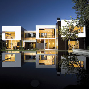 Inspiration for a large modern white two-story metal flat roof remodel in Los Angeles