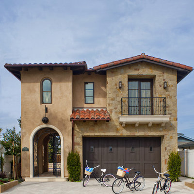 Mediterranean brown two-story exterior home idea in Los Angeles