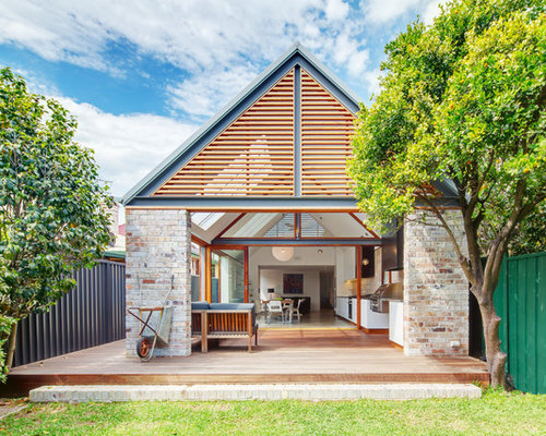 Peach exposed brick houzz for House plans with high pitched roofs