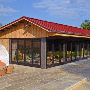 Imagen de fachada de estilo de casa de campo, pequeña, de una planta