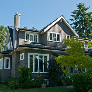 Example of a mid-sized transitional brown two-story wood exterior home design in Vancouver with a tile roof