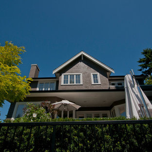 Brown wood exterior home idea in Vancouver