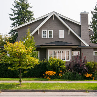 Inspiration for a mid-sized transitional brown two-story wood exterior home remodel in Vancouver with a shingle roof