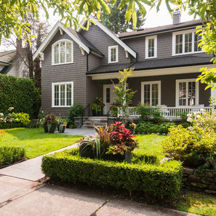 Large transitional brown two-story wood exterior home idea in Vancouver with a shingle roof