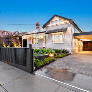 This is an example of a transitional two-storey white exterior in Melbourne with wood siding.