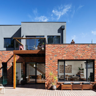 Photo of an industrial two-storey multi-coloured house exterior in Melbourne with mixed siding and a flat roof.